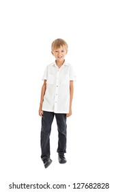 Studio portrait of a handsome European boy in white shirt and black trousers. Studio shot, isolated on white background.