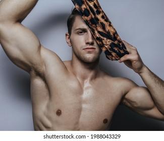 Studio portrait of handsome man with leopard scarf