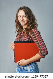 a studio portrait of a happy young female student