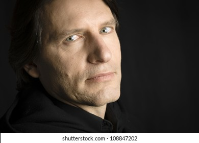 Studio Portrait of a man with an intense look staring directly to the camera