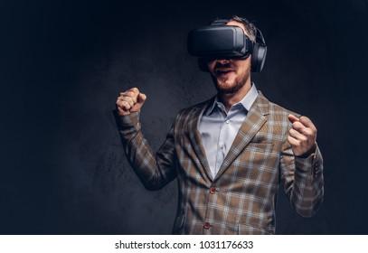 Studio portrait of a man wearing virtual reality glasses on a da