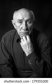 Studio portrait of an old man