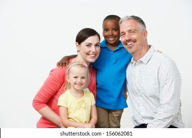 Studio Portrait Of Pre School Teachers With Pupils