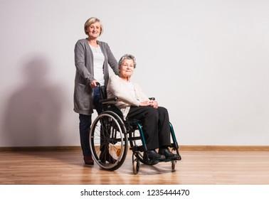 Studio portrait of a senior women in wheelchair.
