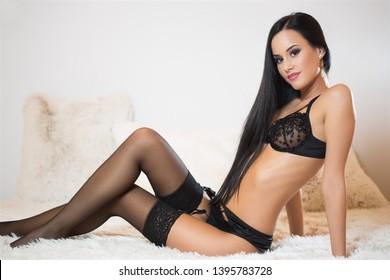 Studio portrait of sensual brunette in elegant lingerie.