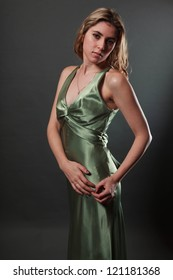 Studio portrait of a sexy blonde girl in an evening gown
