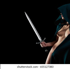 Studio portrait of a sexy young woman with stunning hot perfectly shaped body posing naked wearing hooded cape covering her face holding a sword copyspace guard guarding warrior brave nudity breast.