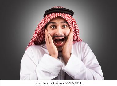 Studio portrait of a shocked arabian man