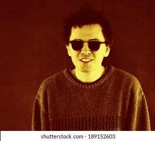 Studio portrait of smiling man in sunglasses.