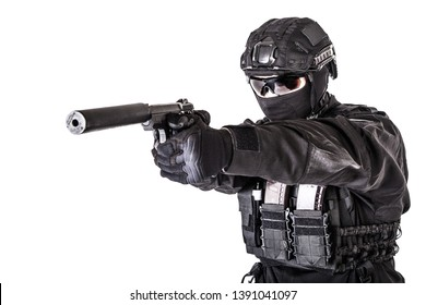 Studio portrait of SWAT officer aiming with pistol