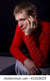 studio portrait of the thoughtful forty-year-old man on a black background