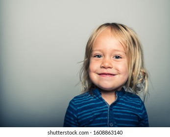 Studio portrait of a toddler doing smiling faces