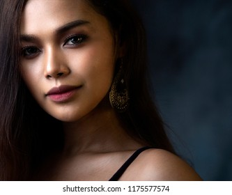 Studio portrait of a Transgender Thai model  with a grey background