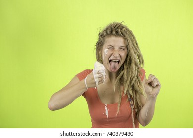 Studio Portrait of a Woman with Dreadlocks and an Ice Cream