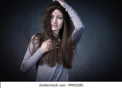 studio portrait of woman with long hair