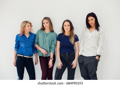 Studio portrait of a woman team of colleagues standing together against white background