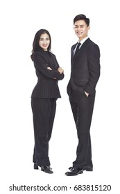 studio portrait of young asian business man and woman, looking at camera smiling, isolated on white background.
