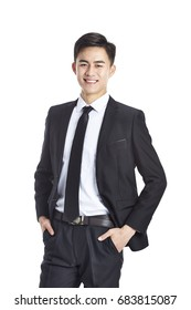 studio portrait of a young asian businessman in formal wear, hands in pockets, isolated on white background.