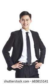 studio portrait of a young asian businessman in formal wear, arms akimbo, isolated on white background.