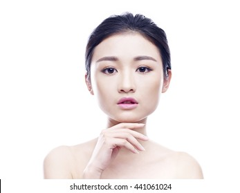 studio portrait of a young asian woman, looking at camera, hand on chin, frontal view, isolated on white.