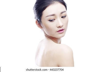 studio portrait of a young asian woman, side view, isolated on white.