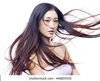 studio portrait of a young and beautiful asian fashion model, isolated on white background.