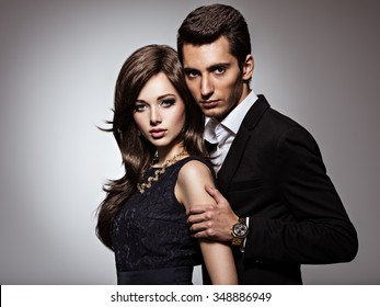 Studio portrait of young beautiful couple in love