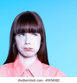 studio portrait of a young bored woman on isolated background