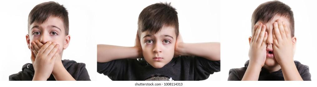 Studio portrait of young boy - see no evil, hear no evil, talk no evil concept
