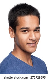 Studio portrait of a young ethnic adult smiling to camera.