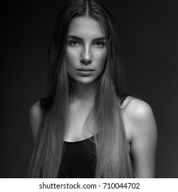 Studio Portrait of young female model black and white