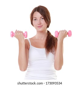 Studio portrait of a young girl in a vest and shorts engaged with dumbbells/Theme healthy lifestyle sports