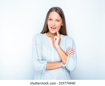 studio portrait of young happy smiling girl posing for business shot