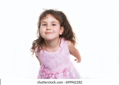 studio portrait of young happy smiling preschooller girl over white background