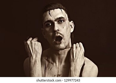 Studio portrait of a young man strangling himself thread closeup