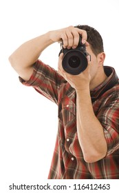 Studio portrait of young man taking picture over white
