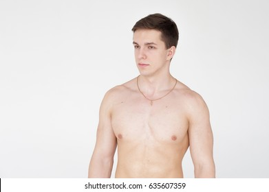 studio portrait young sexy men bodybuilder athlete, with a bare torso, Standing in full length on a white background in underwear underwear, Belt is photographed, gold chain with a cross on the neck