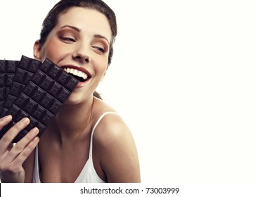 Studio portrait of a young woman with a brick of chocolate isolated on white background