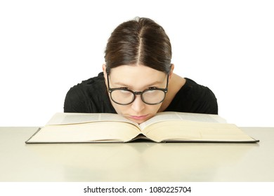 Studio portrait of young woman in front of big book on the table, don't feel like studying concept