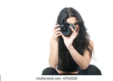 studio portrait of young woman taking picture over white