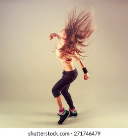 Studio shoot of active female funk jazz dancer moving. Sport and leisure concept. Zumba Dance.