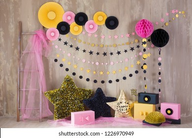 Studio shoot with decor inspired by designers and florist soul with colorful paper flowers on wall and black golden star pillows. Super star pillow deisined by photographer