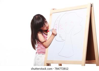 studio shoot of lovely little girl stand by the blackboard