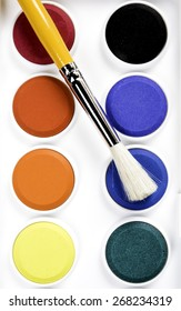 Studio shoot of palette with colors and brush