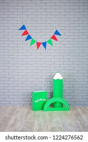 Studio shoot of school book pencil colorful flags on grey brick wall. School study decorations.On green book written on russian - Mathematics