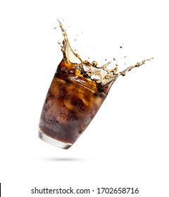 Studio shooting Cola splashing out of a glass.Cola in glass with splash of ice isolated on white background with clipping path