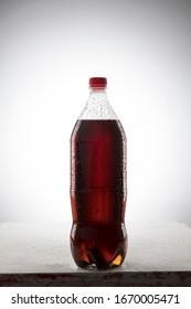 studio shooting of a soda bottle