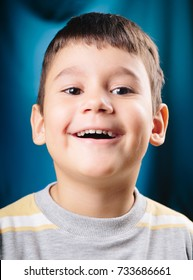 Studio shot of 4 years old boy who is smiling and looking at camera.