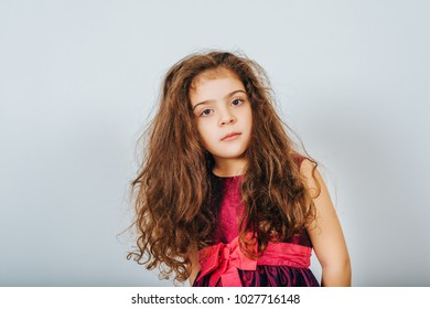 Studio shot of 5 year old kid girl with long curly hair