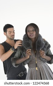 Studio shot of African American model standing with stylist